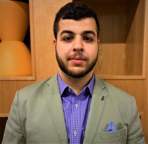 Adam Abutaa's' headshot.